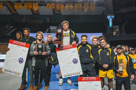 Members of App State's wrestling team pose for a photo after the SoCon Championships on March 8. The Mountaineers had four conference champions and a  program record six total NCAA qualifiers before the season was canceled due to COVID-19.