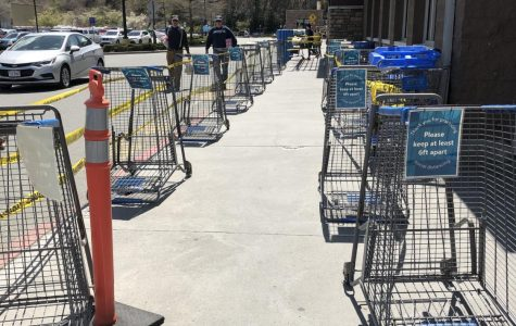 Carts line the entrance to the grocery side of the Boone Walmart. The carts are there to limit the number of people in Walmart at a time.