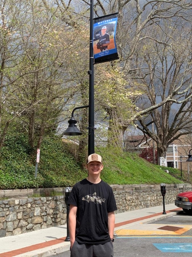 Watauga+High+School+senior+baseball+player+Austin+Idol+poses+under+his+banner+on+King+Street+in+downtown+Boone.+