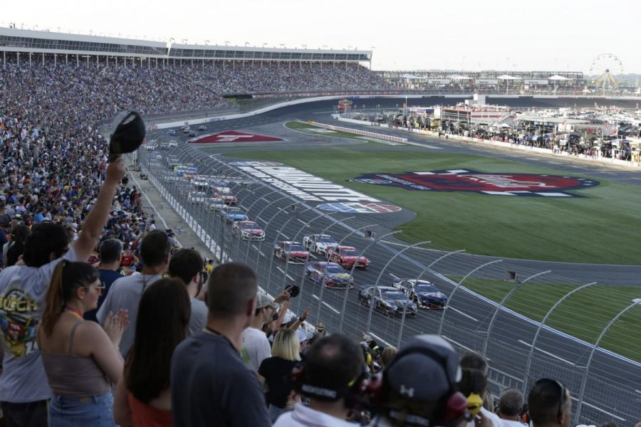 Fans watch as cars race around the track at last year's Coca-Cola 600 at the Charlotte Motor Speedway. Gov. Roy Cooper announced that this year's Coca-Cola 600 will go on without fans May 24.