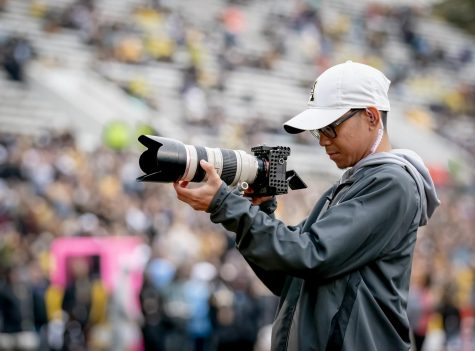 App State student and football video team member Vince Fortea shoots during a game in 2019. The football video team won first place in the Short Social category at this year