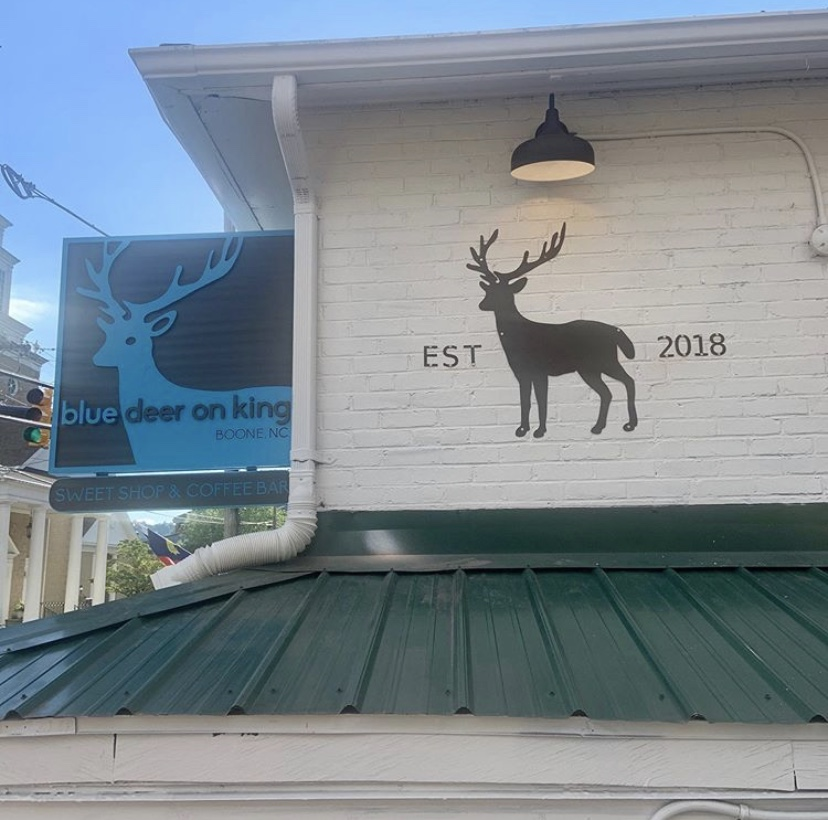 The outside of Blue Deer on King. Customers can see the signature blue deer from its Blowing Rock Location.