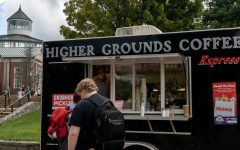 Students wait outside of Higher Grounds Coffee food truck for their orders on Sanford Mall.