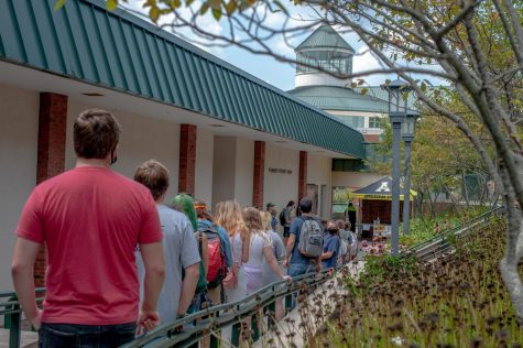 Students wait in line behind the Plemmons Student Union on Wednesday, August 26, 2020.