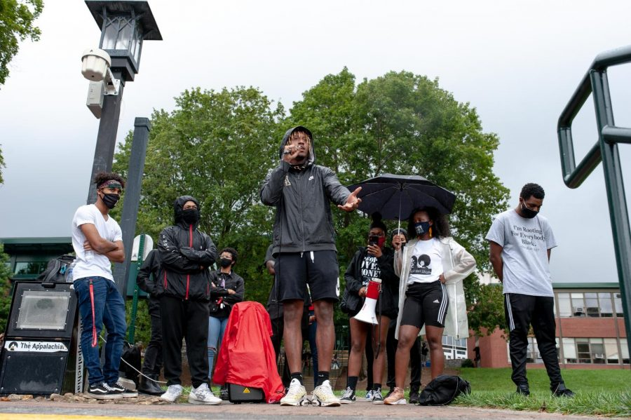 Black+students+were+encouraged+to+speak+during+the+Wake+the+Chancellor+event+on+Sanford+Mall+Aug.+31.+Cam+Peoples+speaks+about+his+experience+with+racial+injustice+on+campus%2C+his+life+growing+up+in+Alabama%2C+and+called+to+those+who+have+power+to+use+it+to+speak+up+against+racial+injustices.