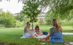 Lauren Hooks, Elizabeth Walton, and Abigail Miles meet together for their weekly Community Group through Reformed University Fellowship in August 2020. To minimize COVID-19 risks and respect one anothers health, they meet outside and wear their masks.