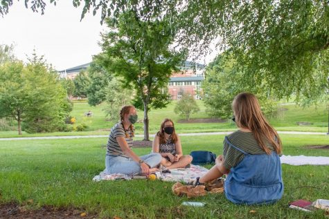Lauren Hooks, Elizabeth Walton, and Abigail Miles meet together for their weekly Community Group through Reformed University Fellowship in August 2020. To minimize COVID-19 risks and respect one another