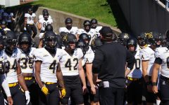 App State head coach Shawn Clark briefly speaks to his team before they take the field against Marshall.
