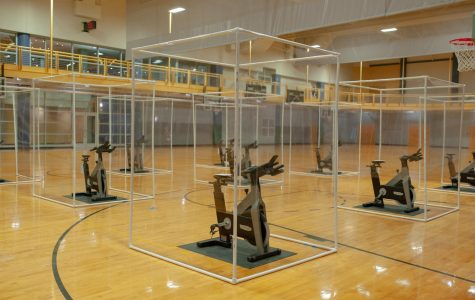 Spin cycles with protective clear plastic for group fitness classes on the SRC gym floor.