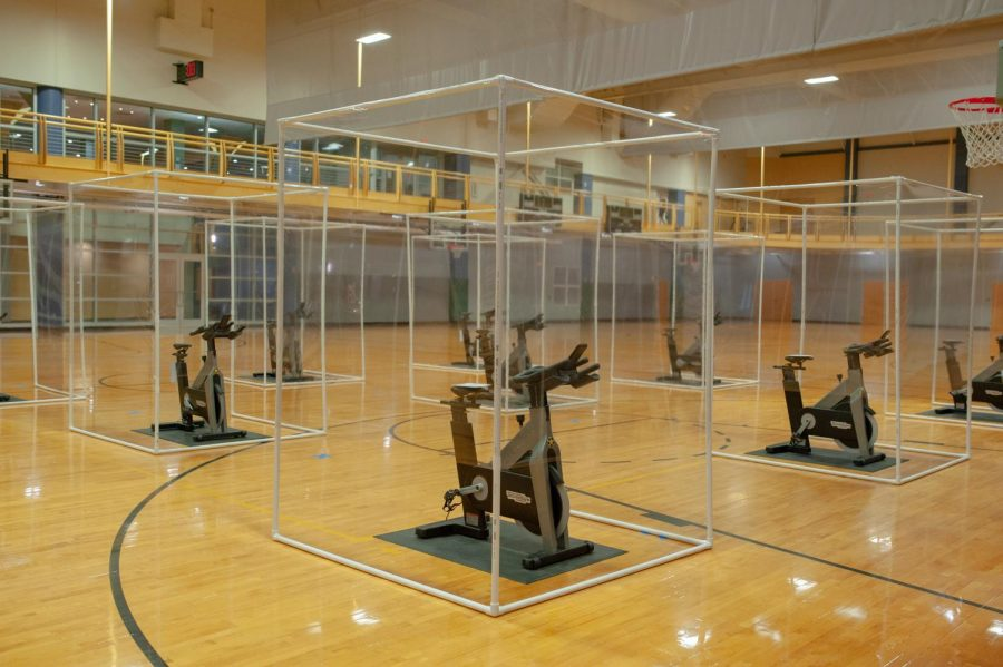 Spin+cycles+with+protective+clear+plastic+for+group+fitness+classes+on+the+SRC+gym+floor.