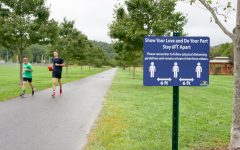 Physical distancing is encouraged for those using the Boone Greenway trail while exercising.