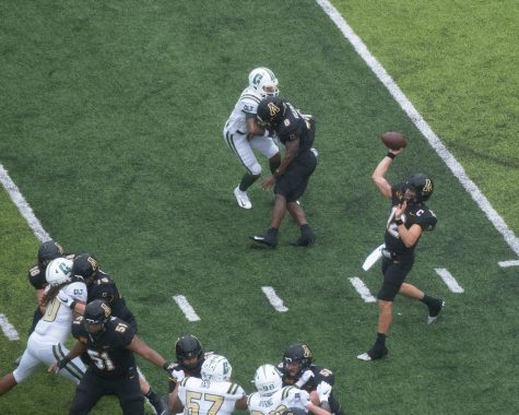 App State senior captain and QB Zac Thomas makes a throw during App State