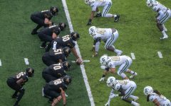 The App State offensive line prepares for a snap in the Mountaineers' 35-20 win over Charlotte Sept. 12. Chancellor Sheri Everts announced three active COVID-19 cases associated with the football team on Thursday.