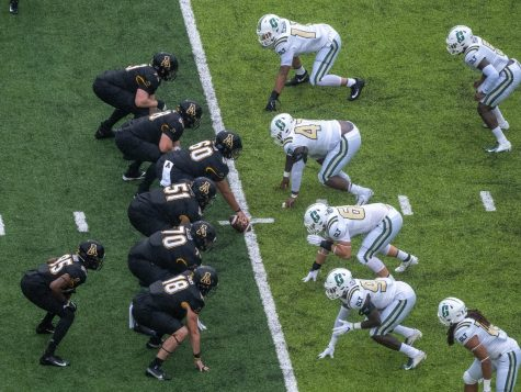 The App State offensive line prepares for a snap in the Mountaineers