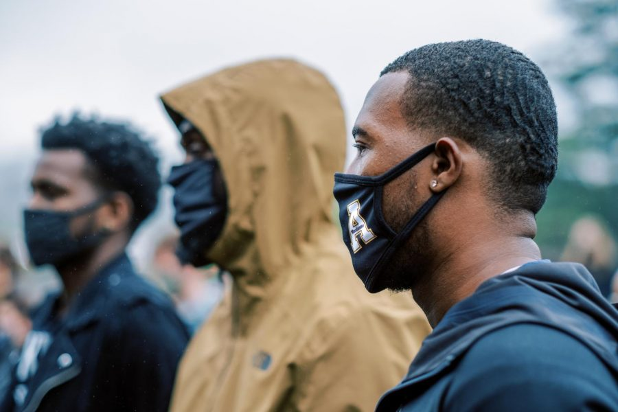 Masked attendees watch and listen speakers at Black in Boone's vigil in honor of Breonna Taylor.
