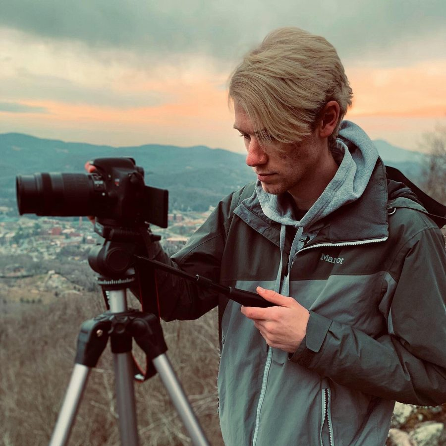 Photographer Riley Curtis takes a photo. Curtiss photography gained popularity on the app TikTok.