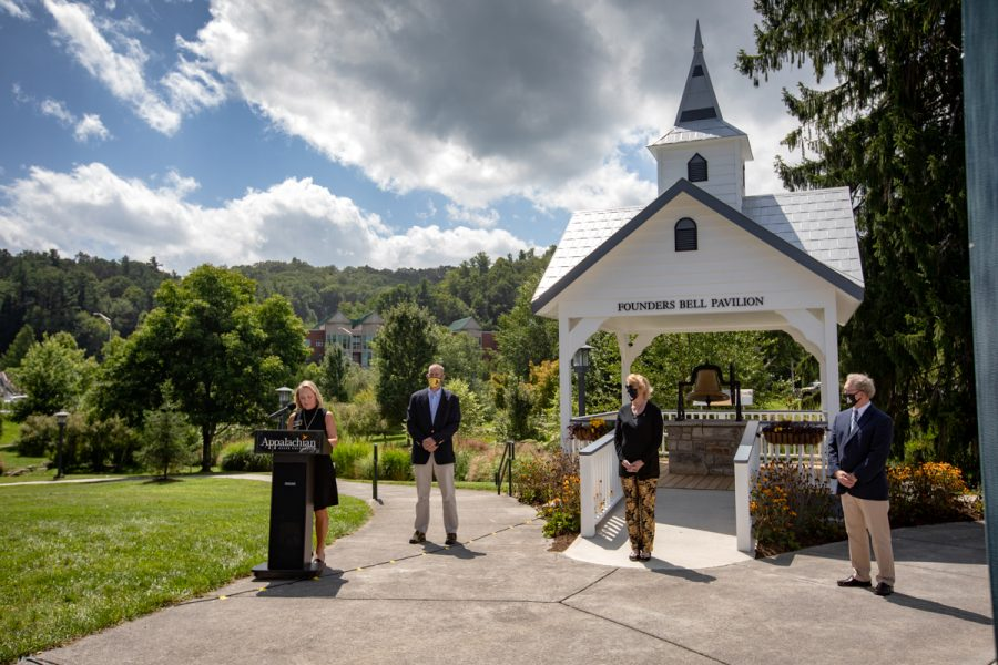 Donna Fiori, far left, president of Appalachian's Alumni Council, provides introductory remarks outside of Founders Bell Pavilion on Appalachian State University's campus during the Founders Day bell ringing ceremony, Sept. 3. Chancellor Sheri Everts, middle, stands with the new bell ringers: Dr. Baker Perry, back left, professor in Appalachian's Department of Geography and Planning, and Dr. Karl Campbell, right, associate professor in Appalachian's Department of History and chair of the university's History Committee.