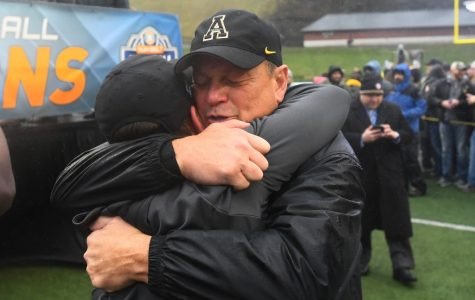 App State defensive coordinator Dale Jones celebrates the Mountaineers 2018 Sun Belt Championship win over Louisiana with an embrace. After spending 2019 at Louisville on former App State head coach Scott Satterfield's staff, Jones is back in Boone for his 24th year with the Mountaineers.