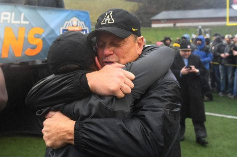 App State defensive coordinator Dale Jones celebrates the Mountaineers 2018 Sun Belt Championship win over Louisiana with an embrace. After spending 2019 at Louisville on former App State head coach Scott Satterfield