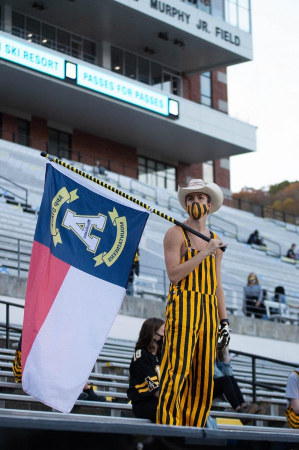 Students decked out in black and gold begin to fill in the student section before the game Oct. 22. A crowd of 2,100 people were welcomed back to The Rock to watch the Mountaineers face off against Arkansas State. Masks and social distancing were enforced.