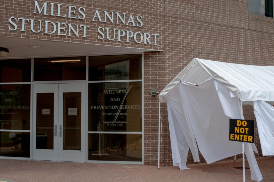 Covid testing tent outside of the Miles Annas Student Support building where students can  get rapid covid testing by appointment.
