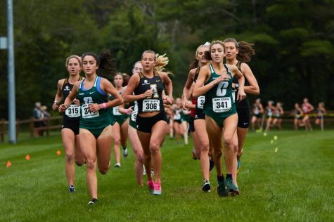 App State womens cross country won first place at the opening meet of the season on Sept. 18. Junior Izzy Evely, center, finished sixth overall.