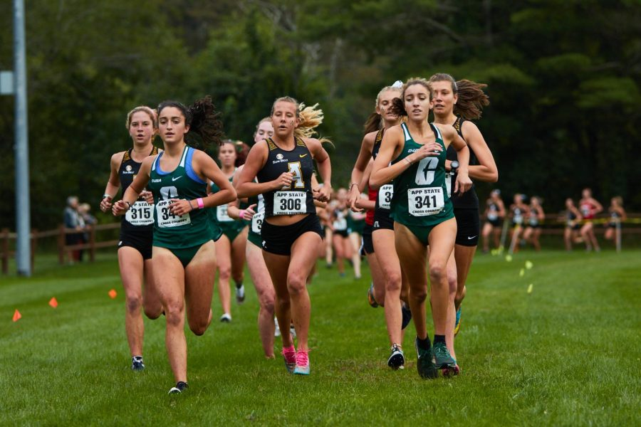App State women's cross country won first place at the opening meet of the season on Sept. 18. Junior Izzy Evely, center, finished sixth overall.