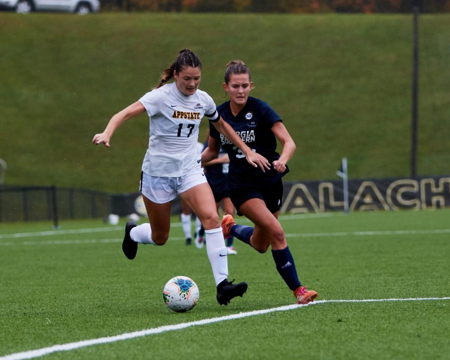 Senior midfielder/forward Tess Cairney holds off a defender during App State's 1-0 loss to Georgia Southern Oct. 11. Cairney and the Mountaineers ended their regular season on a high note, knocking off Coastal Carolina 1-0 Oct. 25 on Senior Day.