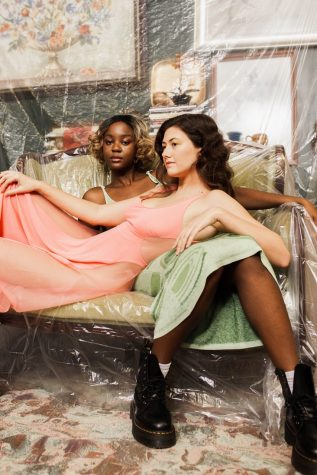 Two models pose during a shoot for The Collective. Students were motivated to start the magazine by the competitive nature of the apparel and fashion industry.