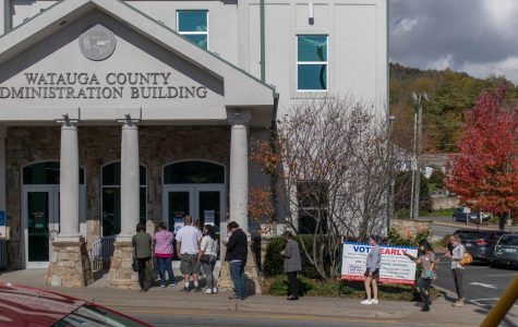Community members wait outside the Watauga County Administration Building on the first day of early voting, October 15, to submit their ballot in the 2020 presidential election.