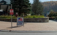 A sign in College Street Circle informs community members that early voting is taking place in the Plemmons Student Union Blue Ridge Ballroom for the 2020 presidential election.