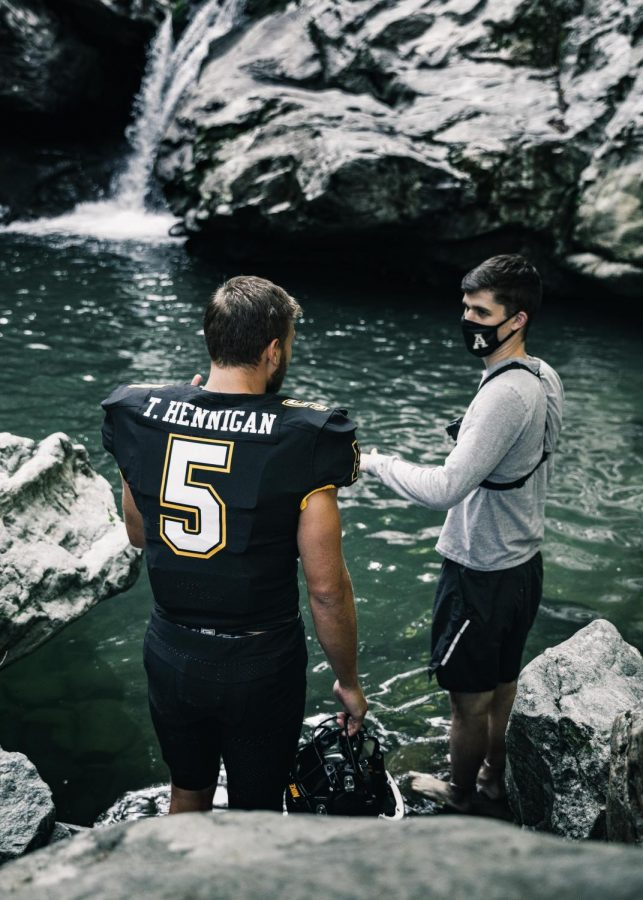 The App State football video team shot a now-viral uniform reveal at Trash Can Falls. The video featured senior wide receiver Thomas Hennigan (left) emerging from underwater. Student Director of Video Production Max Renfro (right) posted the reveal on Tik Tok, where it now has nearly 9 million views.