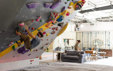 Daelan, an avid climber in Boone, NC, is able to keep strong during the bouldering season by climbing with a mask on at Center 45 on October 1.