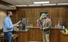 Michael Behrent (right) was sworn onto the Watauga County Board of Elections on Oct. 8 as the chair. He replaced former chair Jane Ann Hodges who resigned due to health concerns.