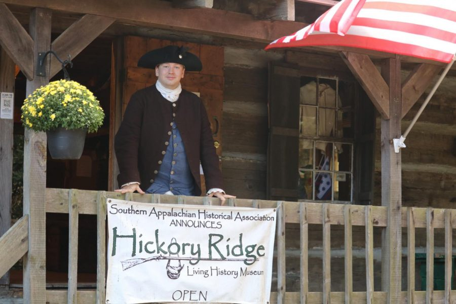 Taylor Osborne in period dress in front of Frazier cabin. The museum's goal is to educate the community about the history of the area.
