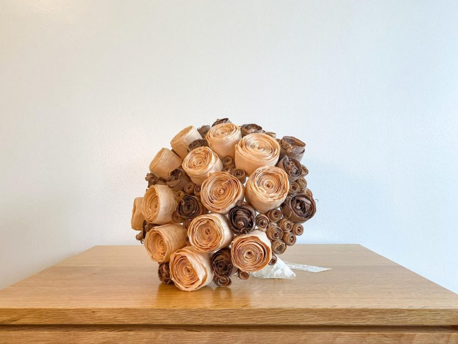 A bouquet made of wood. Bailey Sparks and Alec Bryan opened a business selling wood bouquets after seeing a need for reliable flower providers during COVID.