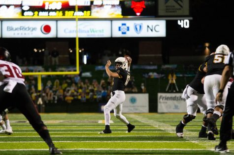 App State senior quarterback Zac Thomas makes a throw during the Mountaineers