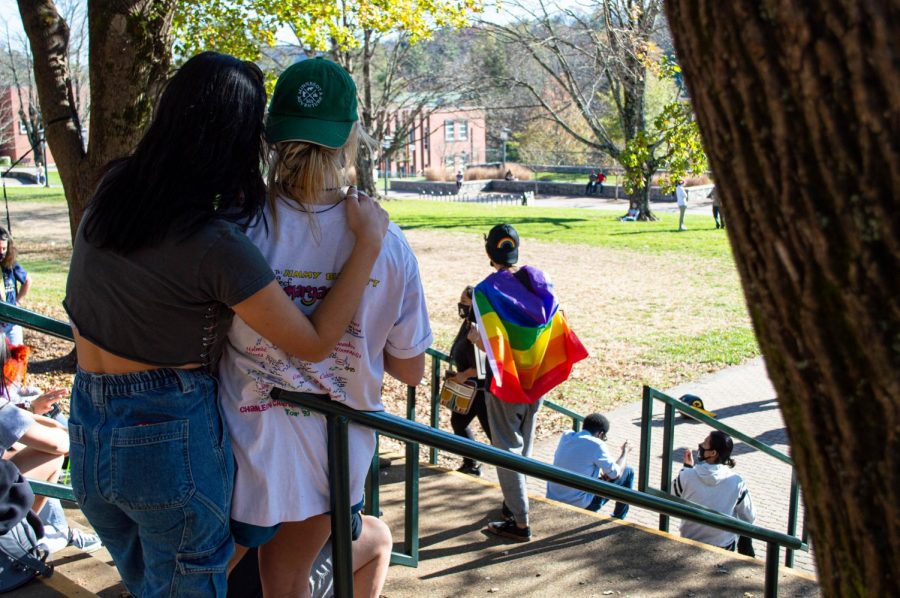 LGBTQ+ supporters looked on as a group of Trump supporters calling themselves