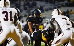 """App State senior quarterback Zac Thomas bounced back from last week's three interception performance and loss to Coastal Carolina by leading the Mountaineers to a 47-10 win over Troy on Saturday. """"I'm proud of our guys. They played lights out, and it was good to get back on the winning side,"""" Thomas said."""