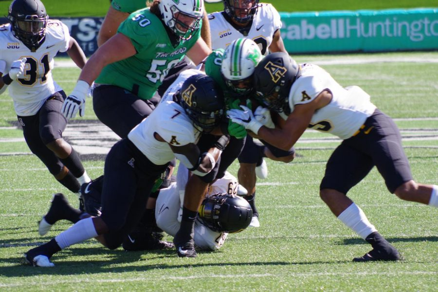 App State junior linebacker Trey Cobb (#7, pictured at left) helps make a tackle during the loss at Marshall Sept. 19. Cobb and fellow junior linebacker D'Marco Jackson have stepped up in 2020 to help fill the holes left by the departure of Jordan Fehr and Akeem Davis-Gaither to the NFL.