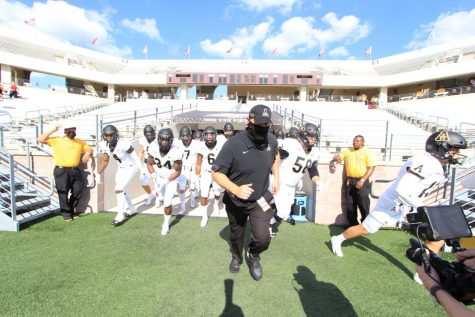 App State head coach Shawn Clark leads the Mountaineers onto the field ahead of the 38-17 victory over Texas State at Bobcat Stadium in San Marcos, Texas Nov. 7.