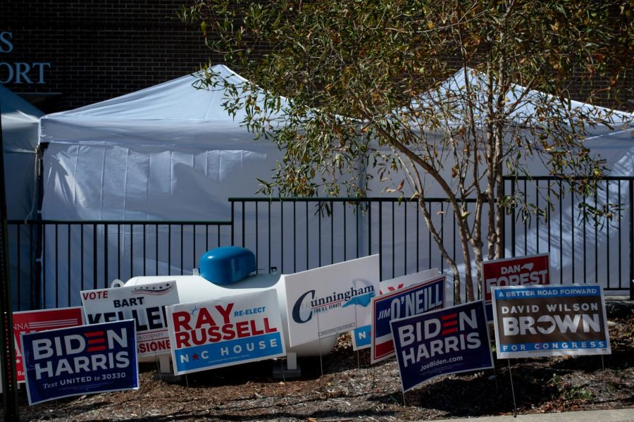 Political candidate signs lined up in front of the COVID testing tents outside of Plemmons Student Union on Election Day.