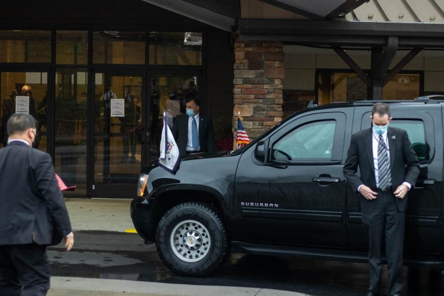 Secret service officials prepare for the arrival of Vice President Mike Pence outside Alliance Bible Fellowship in Boone, NC.