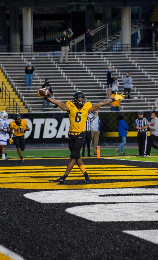App State sophomore running back Camerun Peoples celebrates after scoring the game-winning touchdown in the fourth quarter.