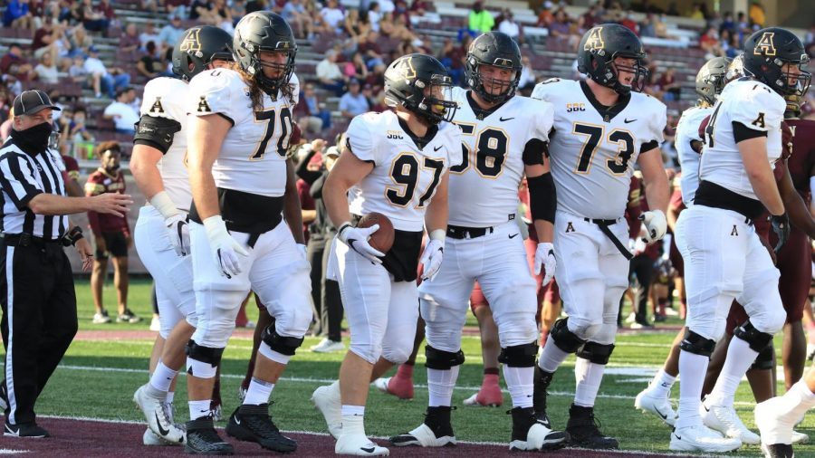 Senior walk on defensive end Caleb Spurlin (#97, center) celebrates with teammates after catching the first touchdown pass of his career in the 38-17 win at Texas State.
