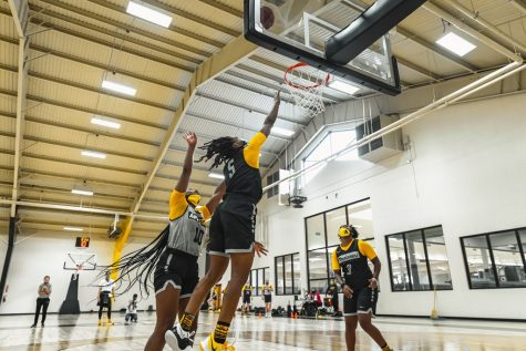 Senior guard Pre Stanley (#5) shoots a layup during an App State women