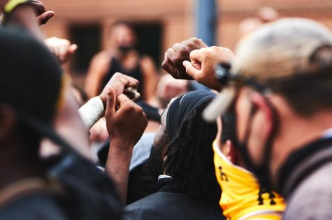 App State football players lead a march protesting racial injustice August 28. Five days before the protest, police shot seven times into Jacob Blake