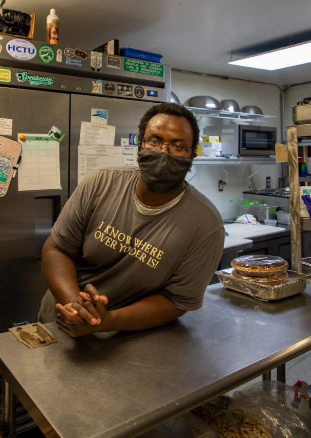 A Boone local and chef for multiple restaurants in the High Country, Ambrose Young looks on to opening his own all-wood barbecue food truck in 2021.