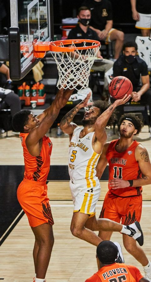 App State grad transfer guard Michael Almonacy attempts to finish at the rim against Bowling Green Nov. 30.