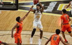 App State junior guard Adrain Delph pulls up against Bowling Green Nov. 30. Delph tied his career-high with 21 points against Charlotte on Friday, including the game winning step back three-pointer.